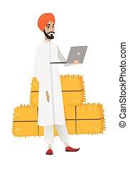Hindu farmer using laptop. - Hindu farmer using a laptop on...