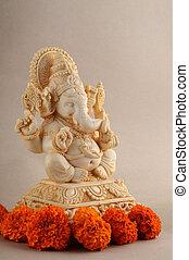 Hindu God Ganesha. Ganesha Idol on background