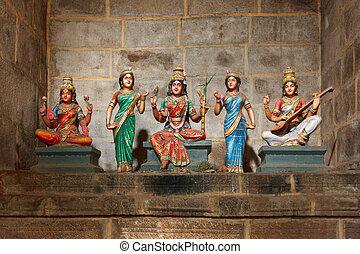 Hindu goddesses Parvati, Lashmi and Saraswati statues in...