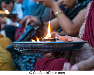 Hindu prayer ritual - detail with hand holding ceremonial fire, Rishikesh India.