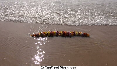 hindu ritual flowers garland in sea - hindu ritual flowers...