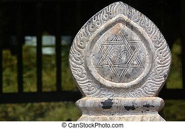 Hindu sign sculpture an Oriental decorations at Nepal Peace...