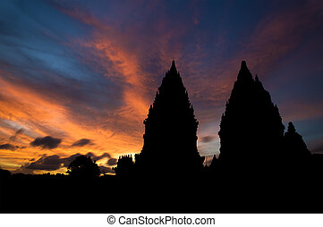 Hindu temple in sunset - Dramatic sky with sun setting at...