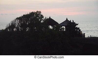Hindu temple on the island Tanah Lot Bali,Indonesia. -...