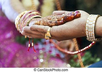 Hindu Wedding Ritual Hand on Hand - Vertical color capture...