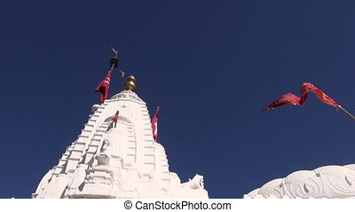 hindu white temple tower and flag