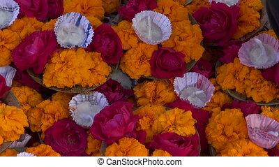 hinduism sacred puja ritual flowers in Varanasi city on old...