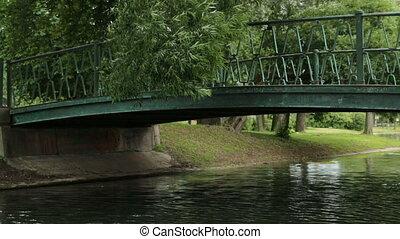 Hinged bridge River tree summer park