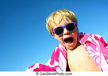 Hip Excited Child in Beach Towel and Sunglasses - a young...