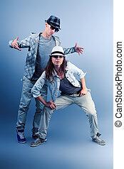 hip hop - A couple of young man and woman dancing hip-hop at...