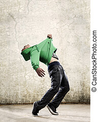 Hip Hop dance - Hip hop dancer pulls himself off the floor