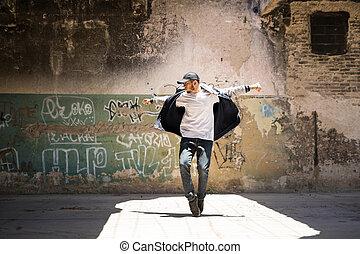 Hip hop dancer performing outdoors