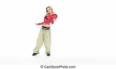Hip Hop Dancing - Attractive blonde woman dressed in baggy...
