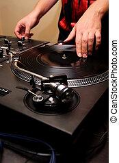 Hip-hop dj scratching the vinyl - Man playing rap music...