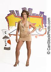 Hip Hop fashion model posing in front of graffiti
