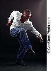Hip hop man dancer against black background