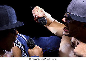 Hip hop subculture battle between two rappers with microphones