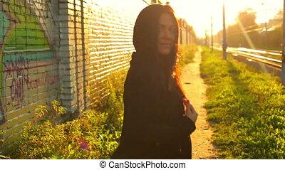 Woman hip-hop woman on urban background.