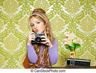 hip retro little girl shooting photo on vintage camera - hip...
