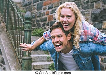 Hip young couple having fun