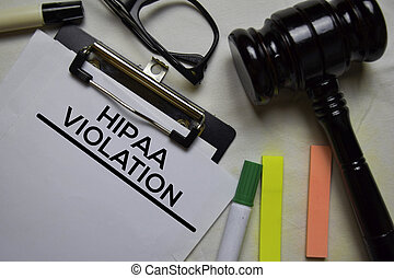Hipaa Violation text on Document and gavel isolated on office desk.