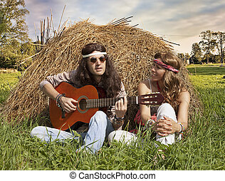Hippie couple  playing guitar