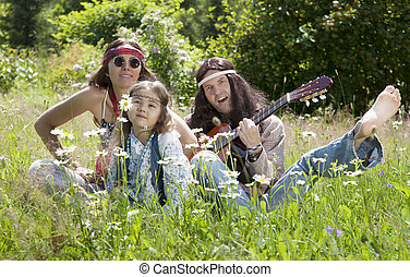 Hippie family playing guitar