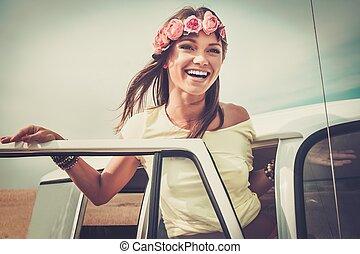 Hippie girl in a van on a road trip