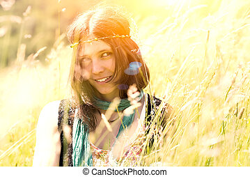Hippie girl in the meadow in a photograph with vintage...