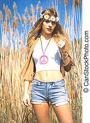 hippie girl with flowers crown if peace symbol