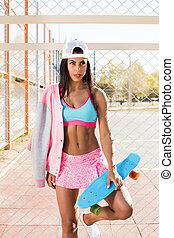 Hippie girl with skateboard.
