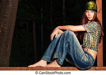 hippie look - young barefoot woman in hippie style clothes,...