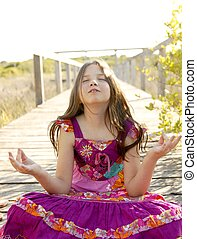 Hippie purple dress teen girl relaxed outdoors