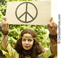Hippie - Real young woman with cardboard with well-known ...