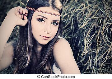 hippie - Romantic young woman posing outdoor.
