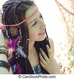 Hippie style young woman with dreadlocks portrait, outdoor