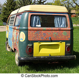 A hippie van painted with bright colors.