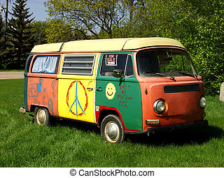 Hippie Van - A hippie van parked on grass.