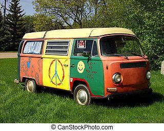A hippie van parked on grass.