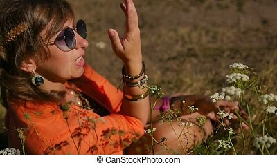 Hippie woman moves to the rhythm of music on a sunny day in ...