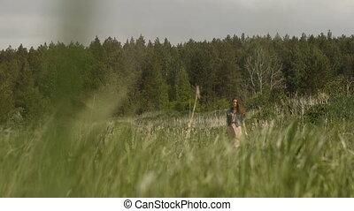 Hippie Woman on green meadow