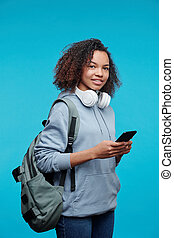 Hipster Afro-American girl with smartphone