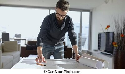 Hipster architect working from home, sketching a housing...
