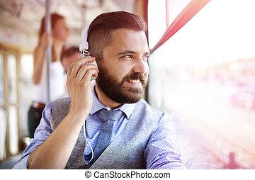 Hipster business man on tram - Handsome hipster modern man...