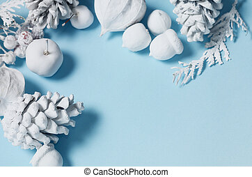 hipster conceptual minimalist christmas and new year background pine cones and branches physalis flowers white objects on a blue background with space