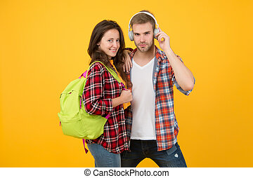 hipster couple ready for learning. ebook and audio book concept. study together is fun. back to school. Happy students couple with backpack. time to get knowledge. Portrait of students couple