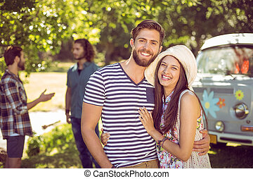 Hipster couple smiling at camera