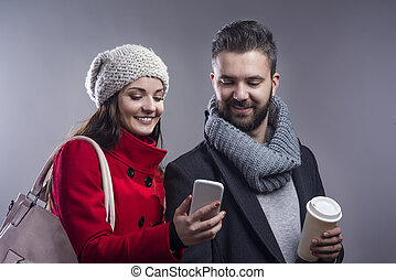 Hipster couple - Trendy young hipster couple with coffee and...
