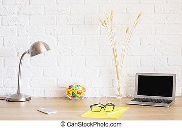 Hipster desktop on brick background