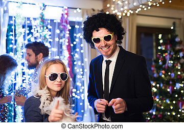 Hipster friends celebrating New Years Eve together, dancing....